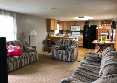 89218 5725 Ave, Wynot - living room + kitchen